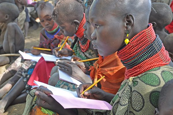 Several children are pictured while attentively taking notes.