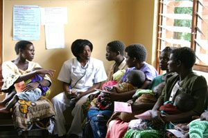A female doctor discusses family planning issues with women at Mchinji Hospital in Malawi.