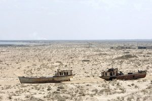 A view of rusted, abandoned ships in Muynak, Uzebkistan, a former port city whose population has declined precipitously with the rapid recession of the Aral Sea. UN Photo/Eskinder Debebe