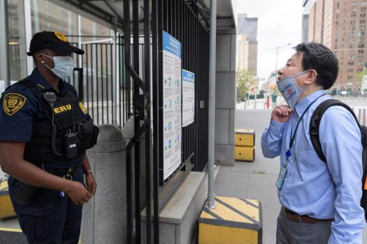 Person showing their face to a UN Security officer
