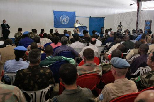 People listening to a speaker at a UN event