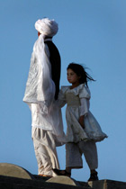 parent and girl child in Herat