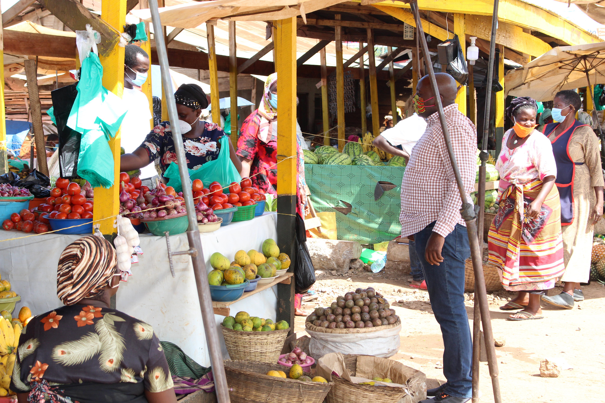 Buyers and sellers practice social distance during the COVID-19 pandemic in the Ugandan marketplace