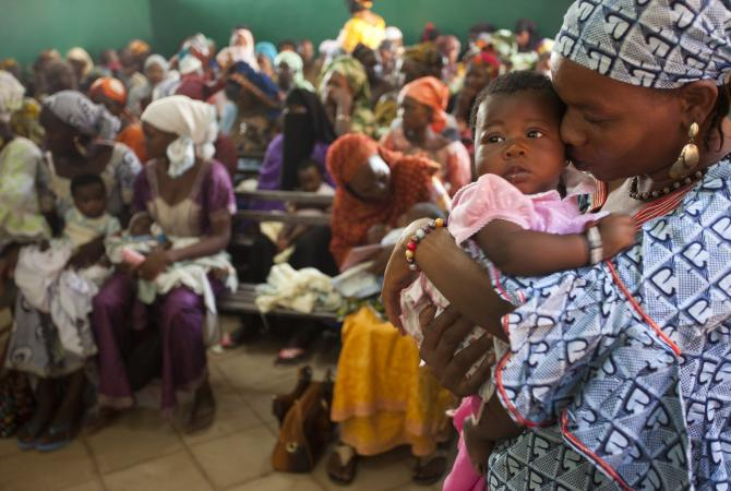 Mothers wait to vaccinate their babies in Bamako, Mali.