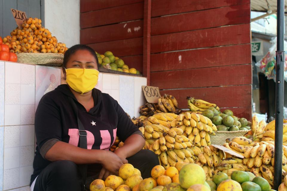 The picture seller use a protective mask to sell their merchandise in Madagascar.