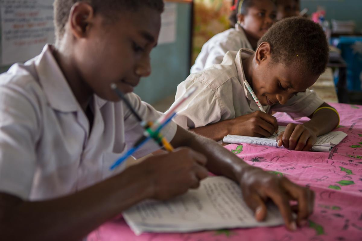 Third grade students mastering literacy skills and acquiring new concepts during class at Norsup Primary School, Vanuatu.