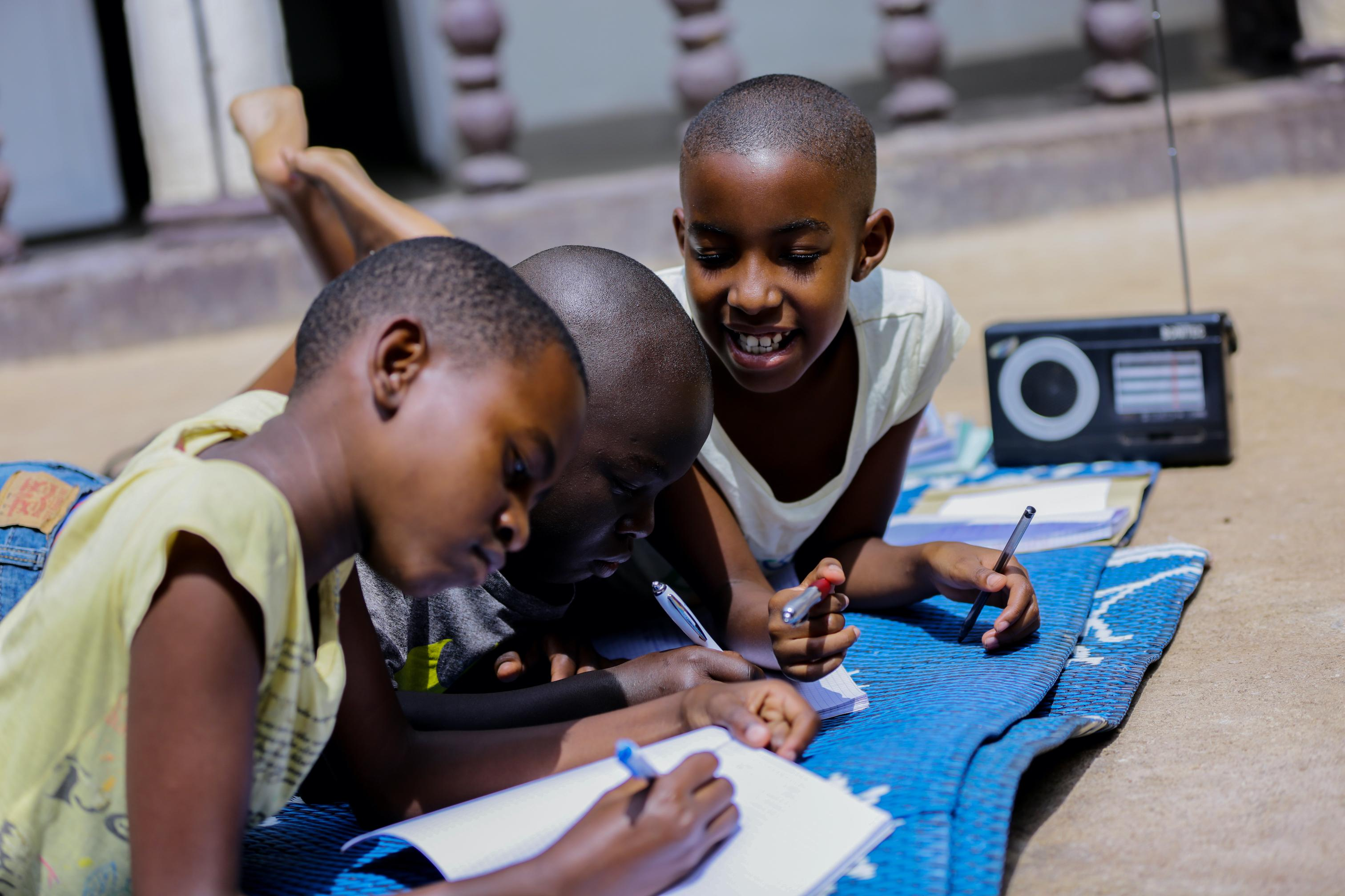 Rwanda's students listen to radio lessons at home while their schools are closed due to COVID-19.