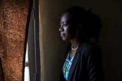 A young woman in the Democratic Republic of Congo looks out the window
