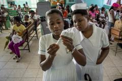 Haitian patients arrive for regular check-ups and vaccinations. Due to COVID-19 they now might