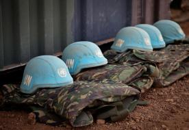 blue helmets and uniforms on the ground