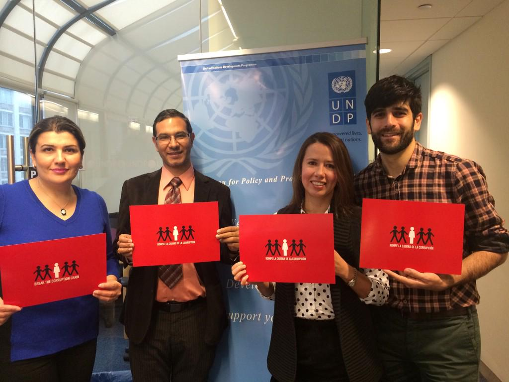 "UNDP's Global Anti-corruption Initiative Team shows off campaign material for ""Break the corruption chain"" campaign."