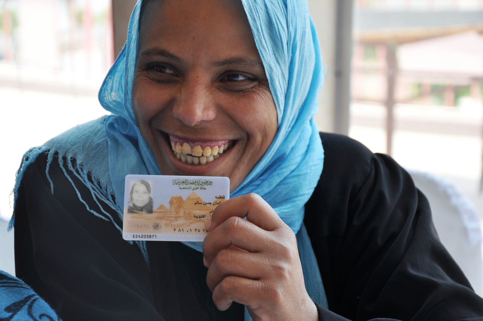 Having an official identification card is key to the rule of law. In this photo, an Egyptian woman holds her card.
