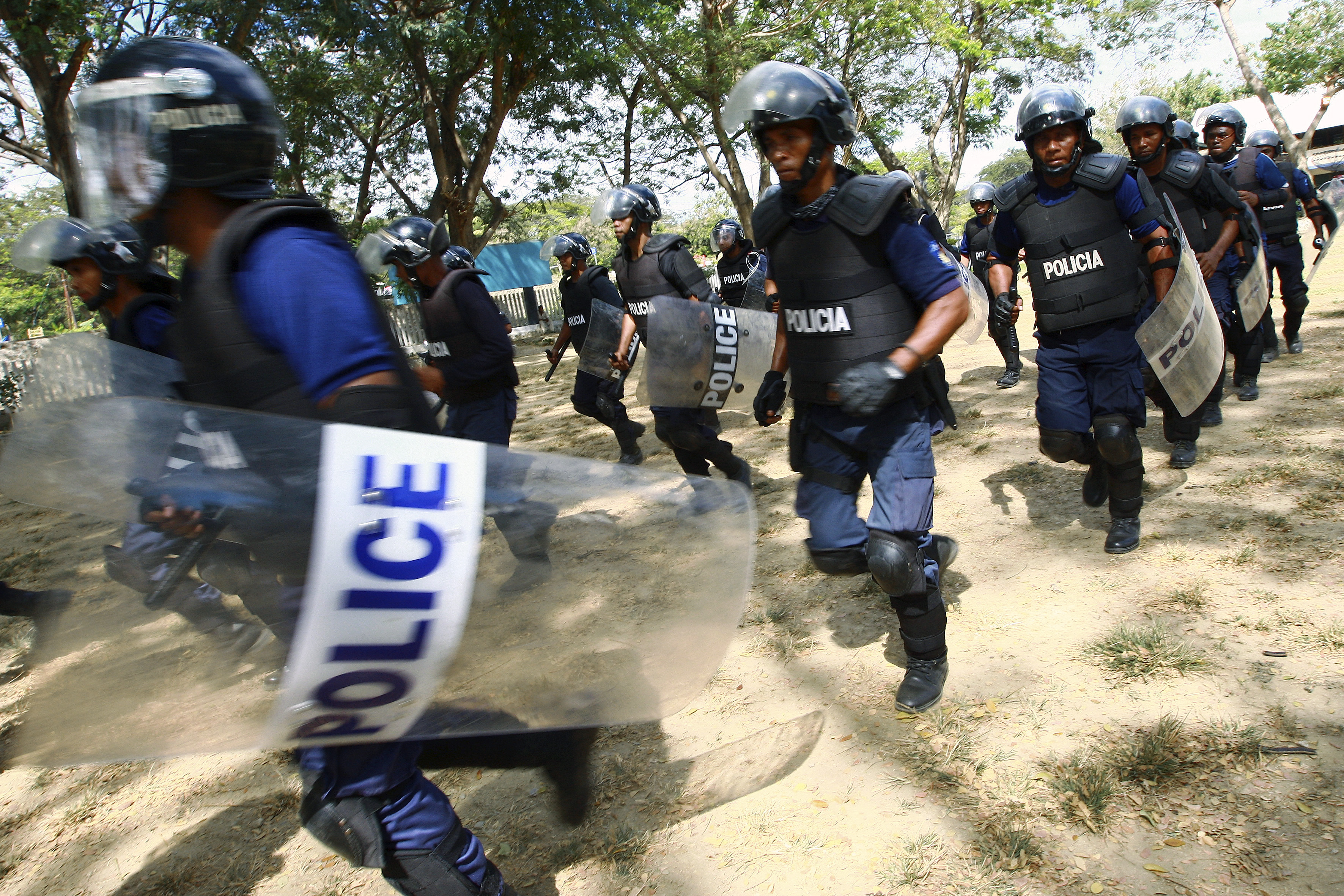 Timorese National Police officers perform a tactical demonstration exercise during a ceremony after a successful completion of a three-week training course facilitated by the United Nations Police component of the United Nations Integrated Mission in Timor-Leste.