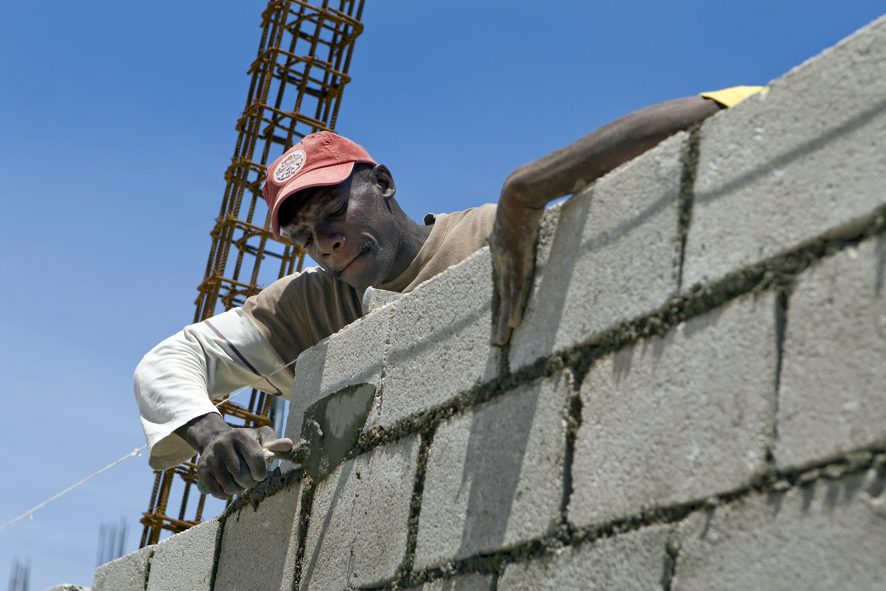 Adequate prisons are key to the rule of law. This worker in Haiti is helping build a new prison to alleviate massive overcrowding in Haiti's only penitentiary in downtown Port-au-Prince.