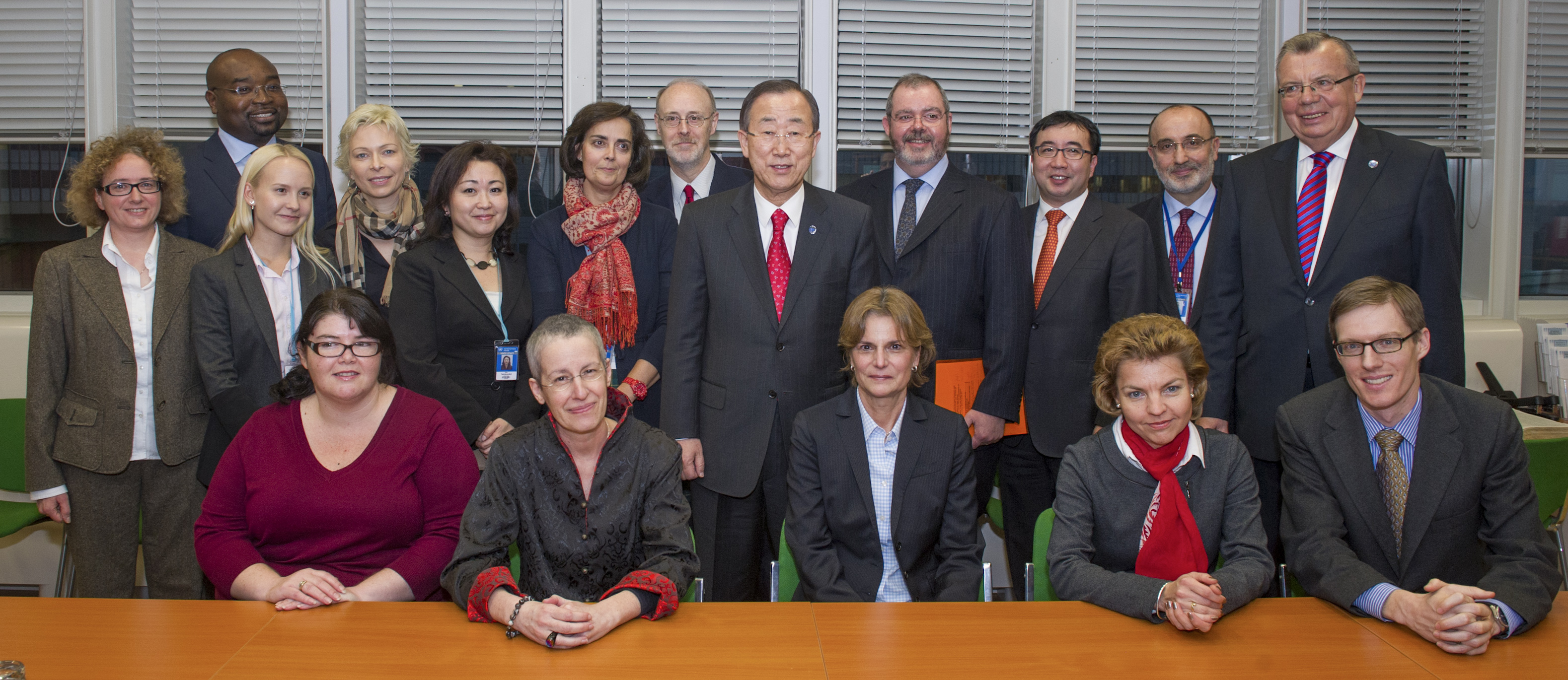 Secretary-General Ban Ki-moon (centre, in red tie) and Yury Fedotov (back row, right), Executive Director of the UN Office on Drugs and Crime (UNODC), pose for a group photo with the Secretariat of the UN Commission on International Trade Law (UNCITRAL) at its offices in Vienna Austria.