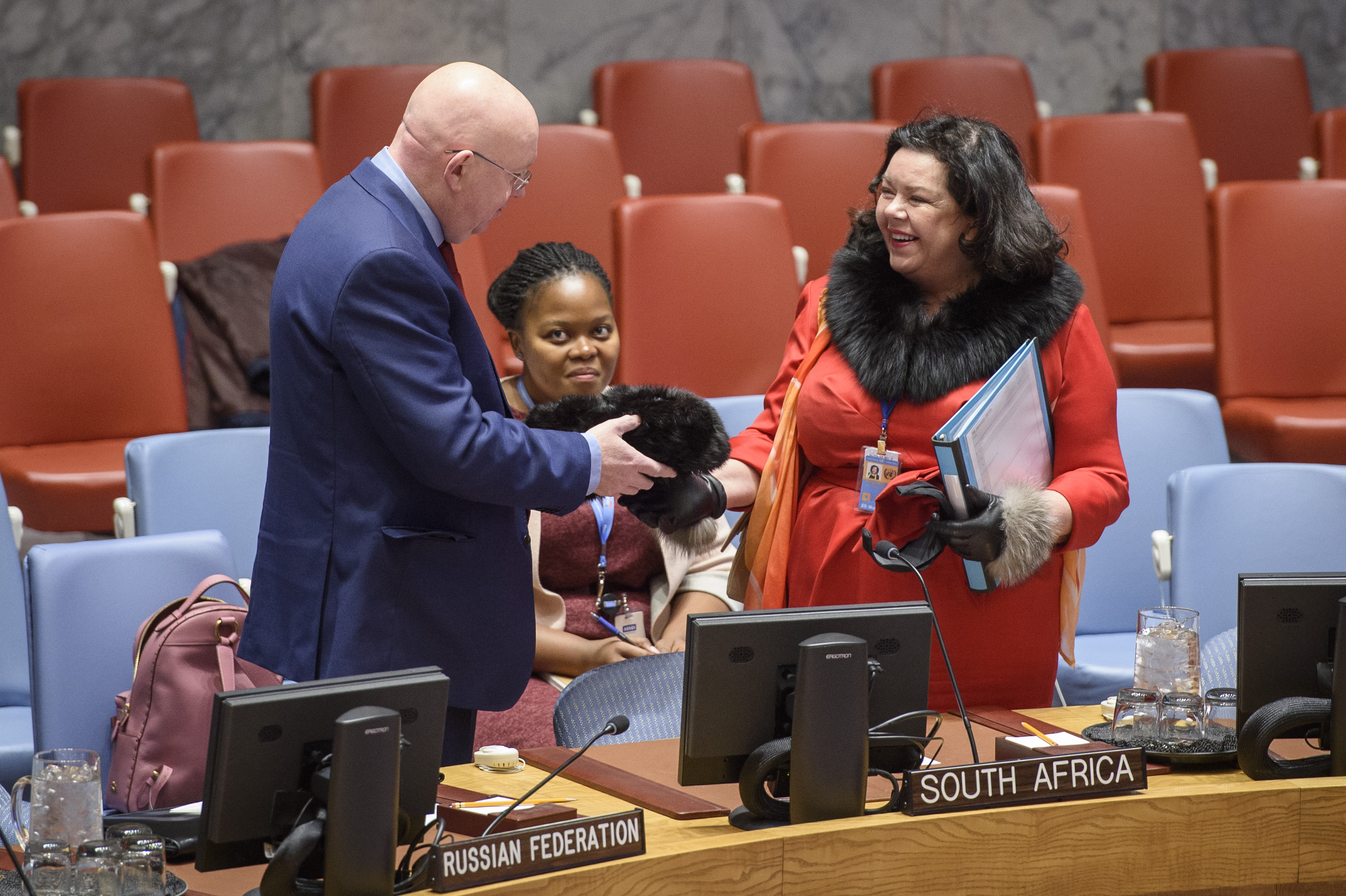 Vassily Nebenzia (left), Permanent Representative of the Russian Federation to the UN, speaks with Karen Pierce, Permanent Representative of the United Kingdom to the UN, before the Security Council meeting on the situation in Libya.
