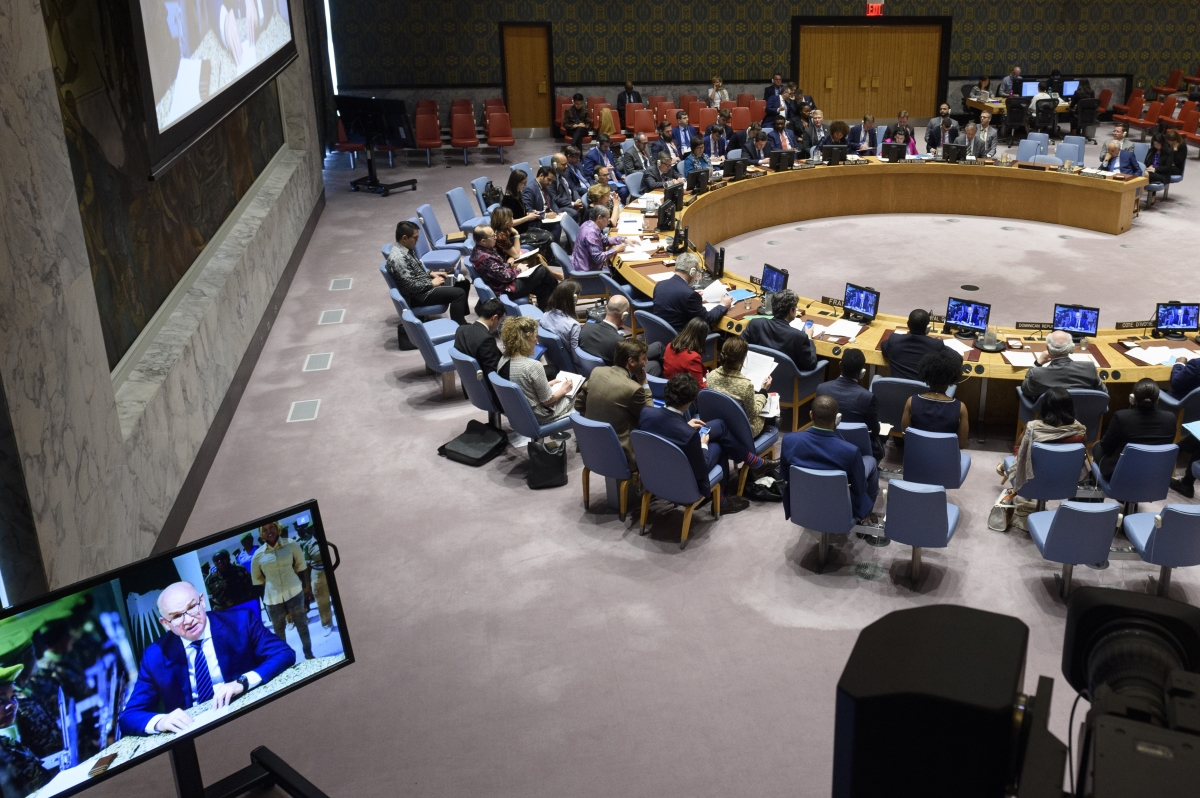 Smaïl Chergui (on screens), Commissioner for Peace and Security of the African Union, briefs the Security Council on the situation in Libya. UN Photo/Loey Felipe