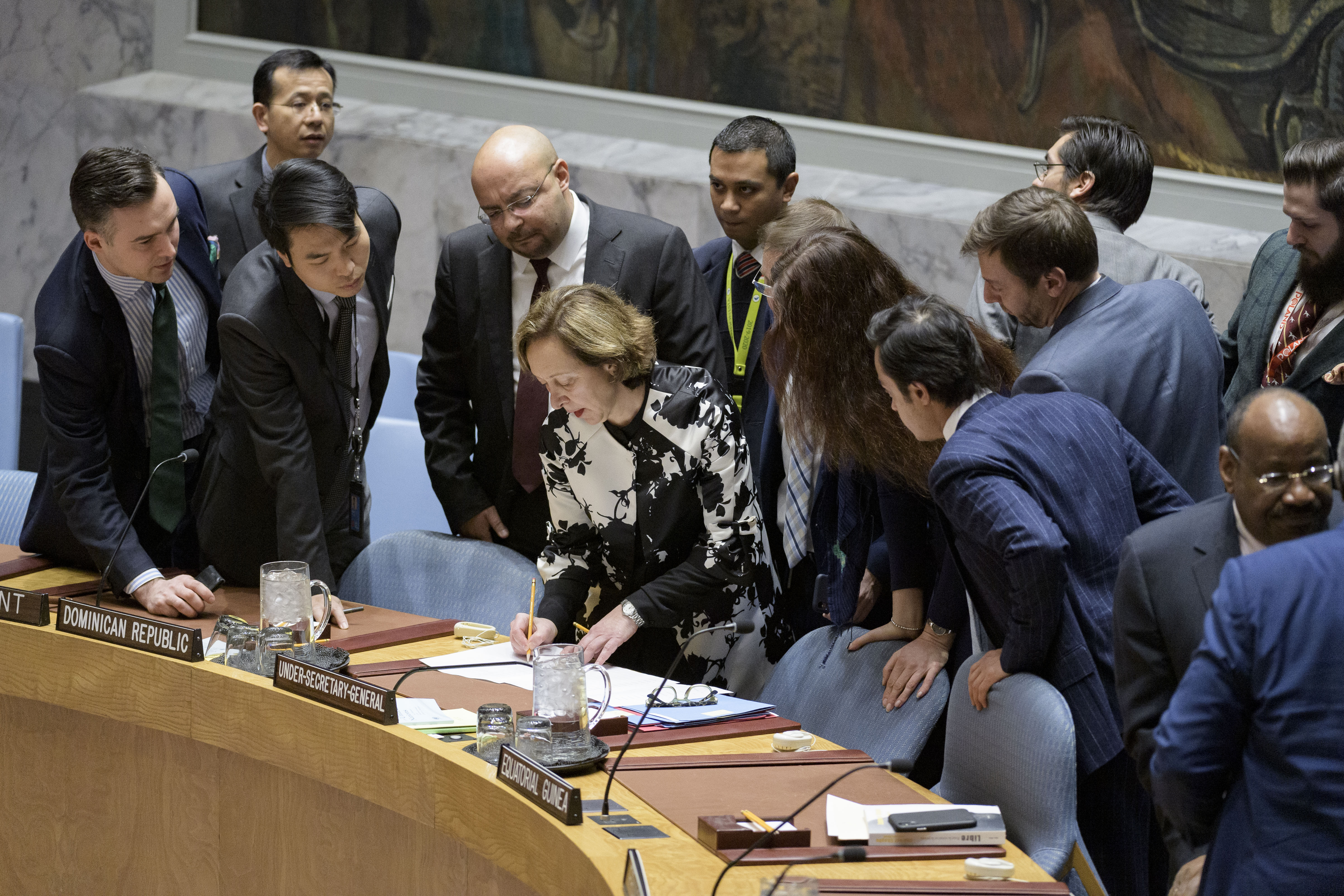 Hasmik Egian (centre), Director of the Security Council Affairs Division of the Department of Political and Peacebuilding Affairs (DPPA), receives requests for interventions ahead of the Security Council meeting on the situation in Venezuela.