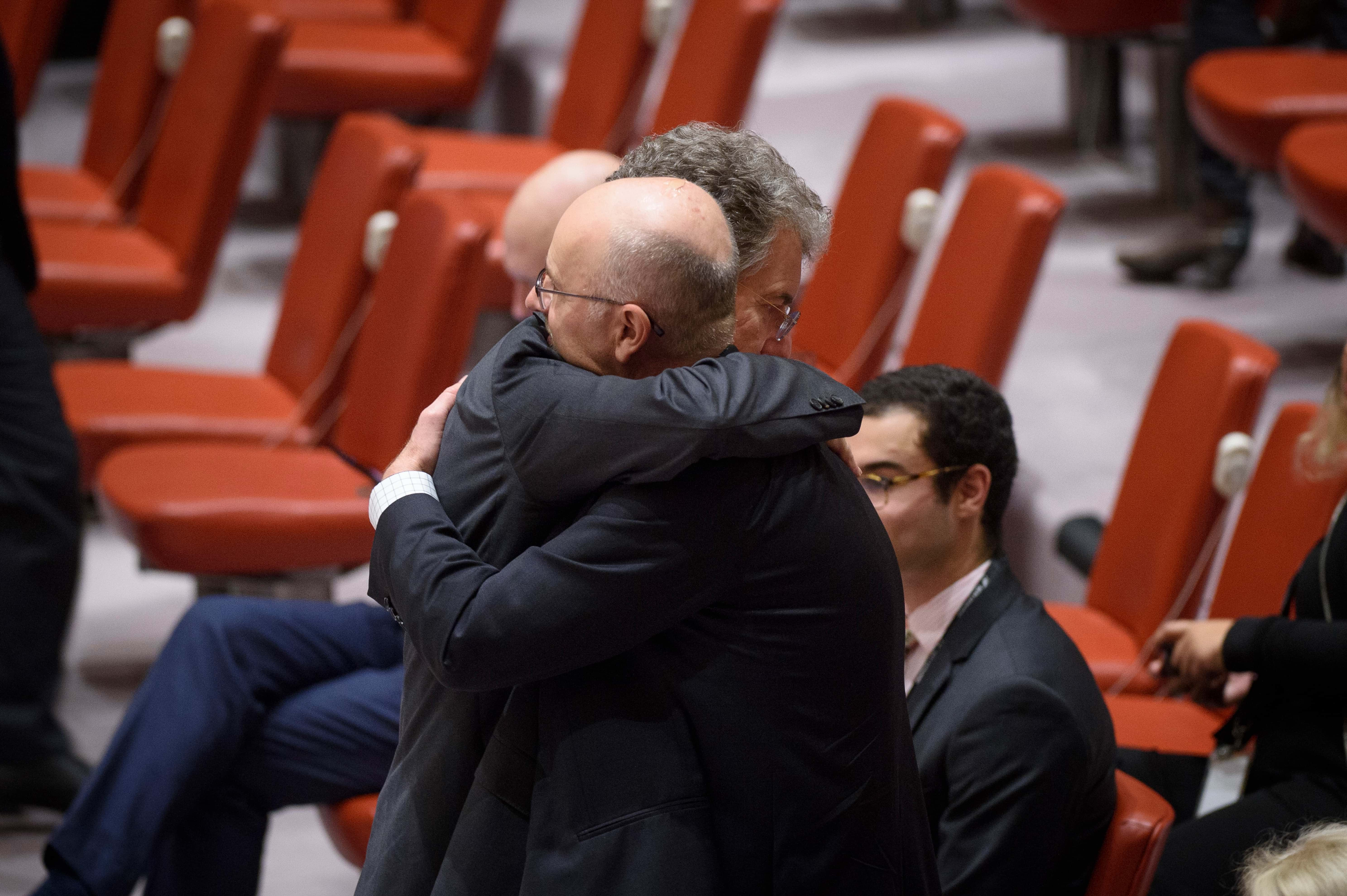 Christoph Heusgen (left), Permanent Representative of Germany to the United Nations and President of the Security Council for the month of March, hugs Craig John Hawke, Permanent Representative of New Zealand.