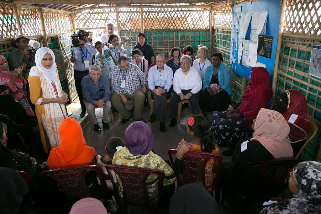 Secretary-General António Guterres (2nd right), World Bank President Jim Yong Kim (center), UNFPA Executive Director Natalia Kanem (right) and UN High Commissioner for Refugees Filippo Grandi interact with Rohingya refugees in Cox's Bazaar, Bangladesh. UNFPA Bangladesh/Allison Joyce