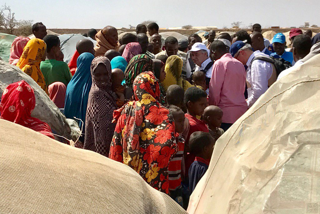 Families displaced by drought in Baidoa, Somalia, gather around Secretary-General António Guterres (white cap), who is in the region urging action to help them. Photo: UNSOM