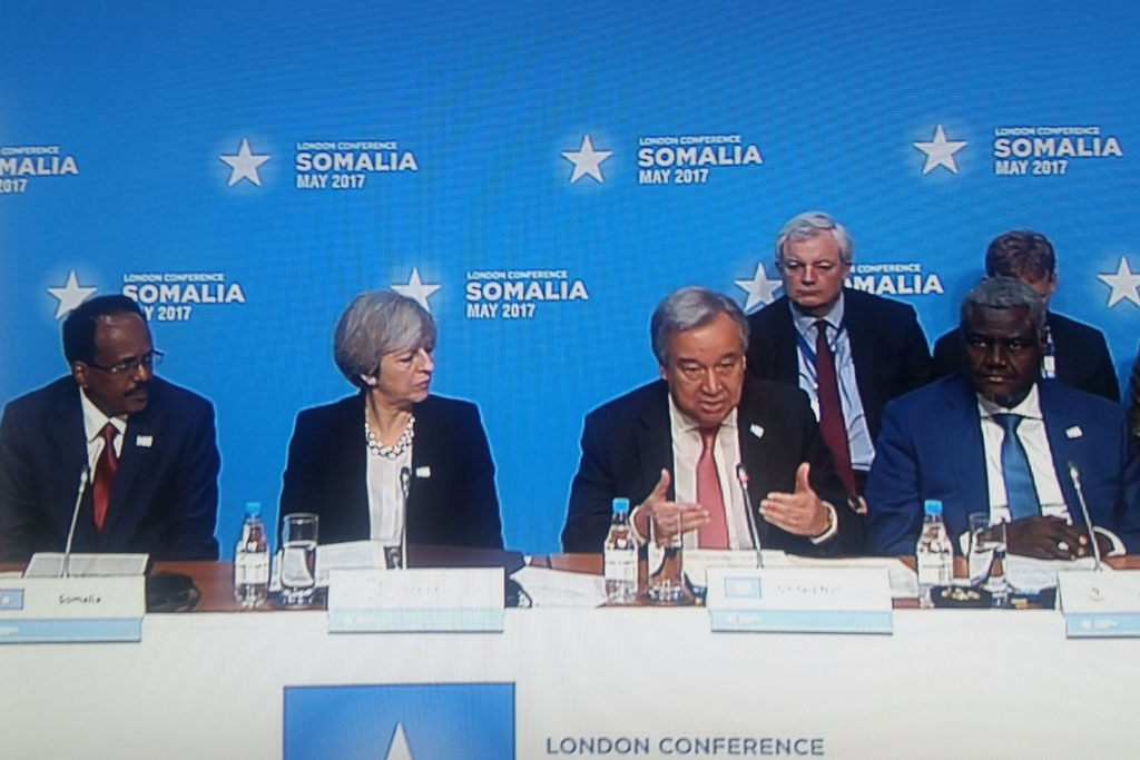 Secretary-General António Guterres delivers opening remarks at the London Somalia Conference, seated with [left to right] President Mohamed Abdullahi Mohamed Farmajo (Somalia), Prime Minister Theresa May (UK) and Chairperson Moussa Faki Mahamat (AU). Photo: OSSG/Mathias Gillmann