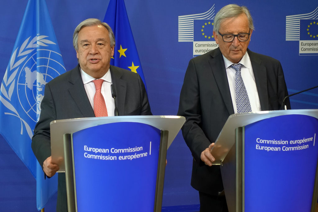 Secretary-General António Guterres (left) and Jean-Claude Juncker, President of the European Commission, address reporters at a press briefing in Brussels. Photo: European Commission