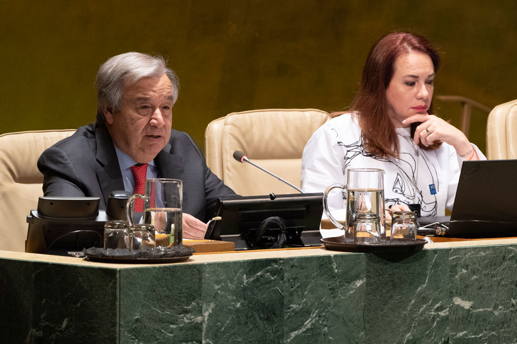 Secretary-General António Guterres (left) addresses the General Assembly commemorative meeting on the occasion of the 70th anniversary of the Universal Declaration of Human Rights. At right is General Assembly President María Fernanda Espinosa Garcés. UN Photo/Evan Schneider