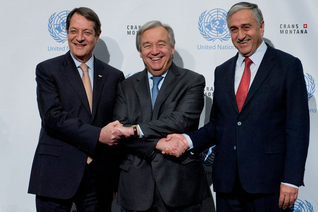 Secretary-General Antonio Guterres with Turkish Cypriot leader Mustafa Akinci (right), and Greek Cypriot leader Nicos Anastasiades (left) during Cyprus talks in Crans-Montana, Switzerland. UN Photo/Jean-Marc Ferré