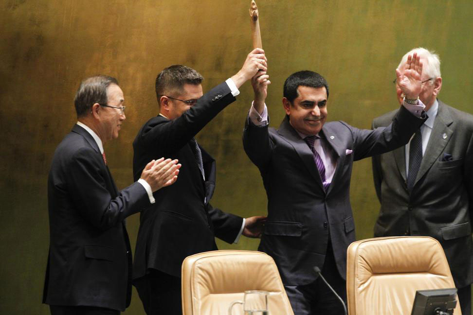 Outgoing President of the General Assembly Nassir Abdulaziz Al-Nasser (second right) hands over the gavel to his successor Vuk Jeremic. Secretary-General Ban Ki-moon is at left. UN Photo/Rick Bajornas
