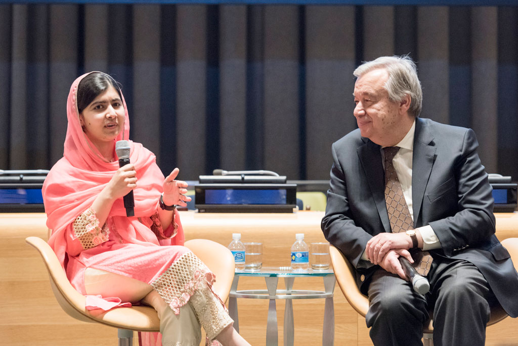 Newly designated Messenger of Peace with a special focus on girls' education, Malala Yousafzai, speaks at a special event as Secretary-General António Guterres looks on. UN Photo/Rick Bajornas