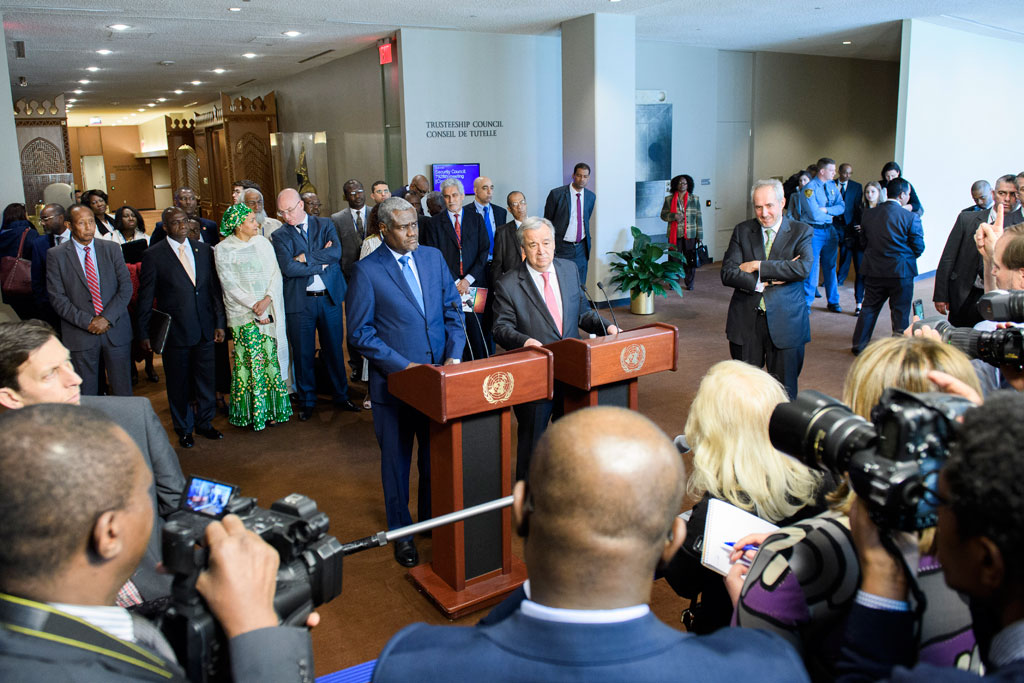 Secretary-General António Guterres (at podium, right) and AU Chairperson, Moussa Faki Mahamat, address the press following the signing of Joint UN-AU Framework for Enhancing Partnerships on Peace and Security. UN Photo/Manuel Elias