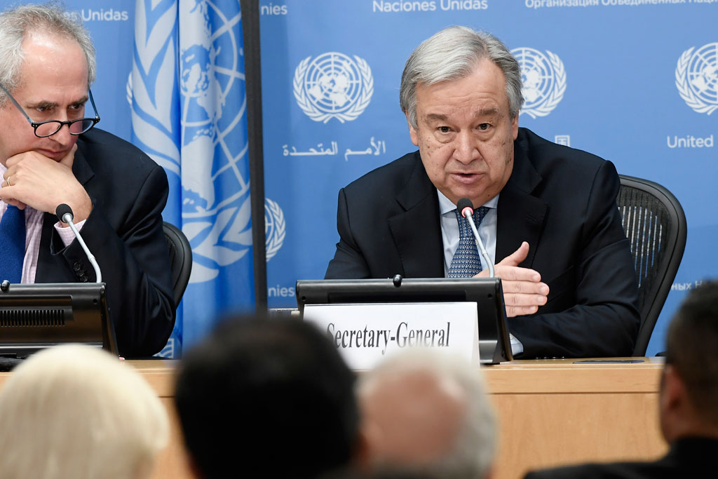 Secretary-General António Guterres (right) addresses journalists at a press conference at UN Headquarters. UN Photo/Evan Schneider
