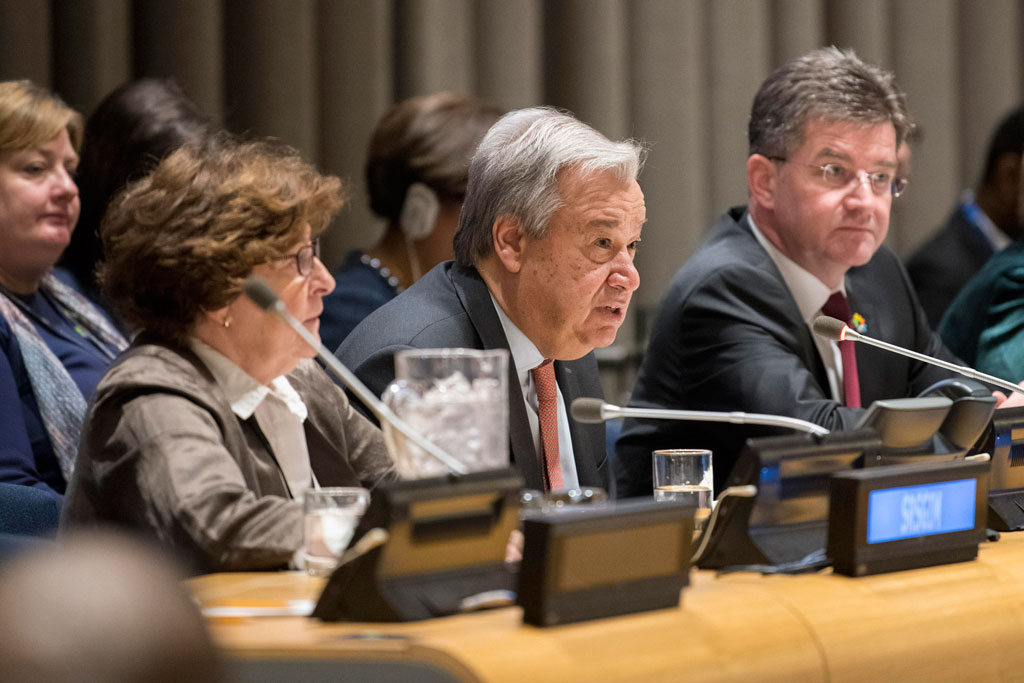 "Secretary-General António Guterres (centre) delivers his report entitled ""Making Migration Work for All"" to the UN General Assembly. UN Photo/Mark Garten"