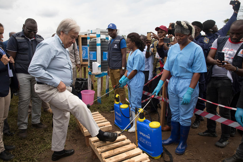 Secretary-General António Guterres visits the Mangina Ebola treatment centre in the eastern Democratic Republic of the Congo. Before entering the town, his shoes are being disinfected. UN Photo/Martine Perret