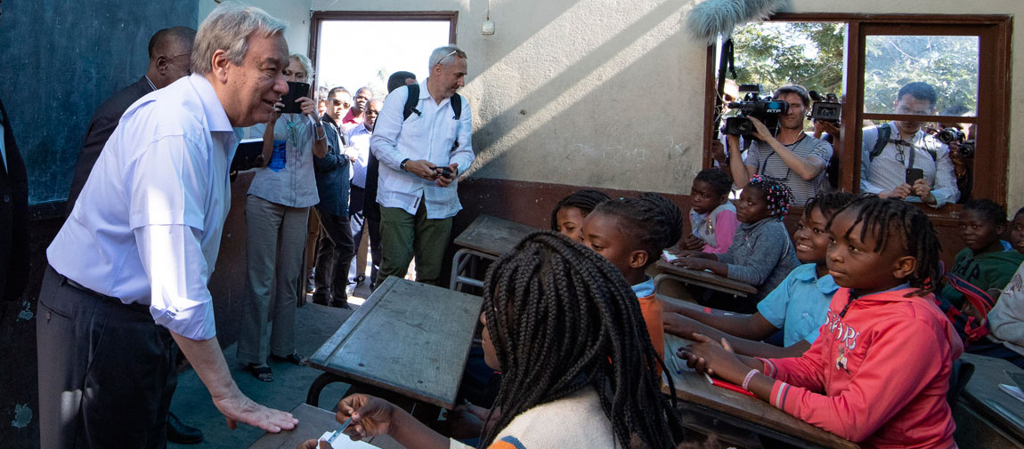 """Secretary-General António Guterres speaks with students at the """"25 de Junho"""" School in Beira, Mozambique, following the aftermath of cyclones Idai and Kenneth. (July 2019) UN Photo/Eskinder Debebe"""