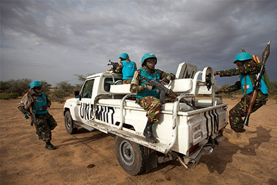 Troops from the African Union-UN Hybrid Operation in Darfur (UNAMID) on patrol in South Darfur, Sudan.