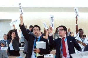 Delegates at a Human Rights Council session, hold up their plaques to request the floor