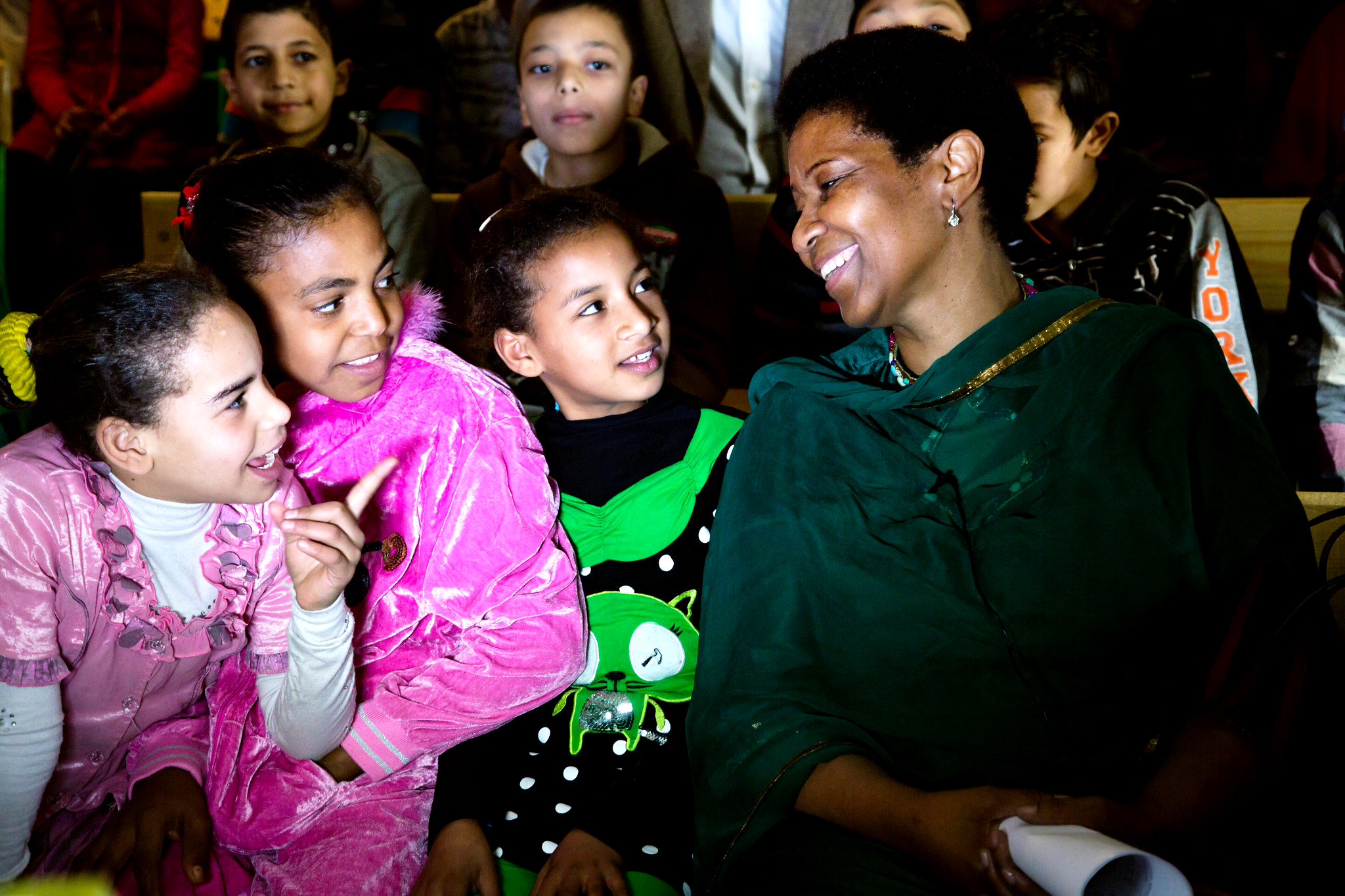 Phumzile Mlambo-Ngcuka laughs with a group of young girls.