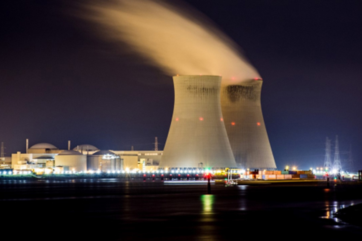 Two nuclear power plant cooling towers at night.