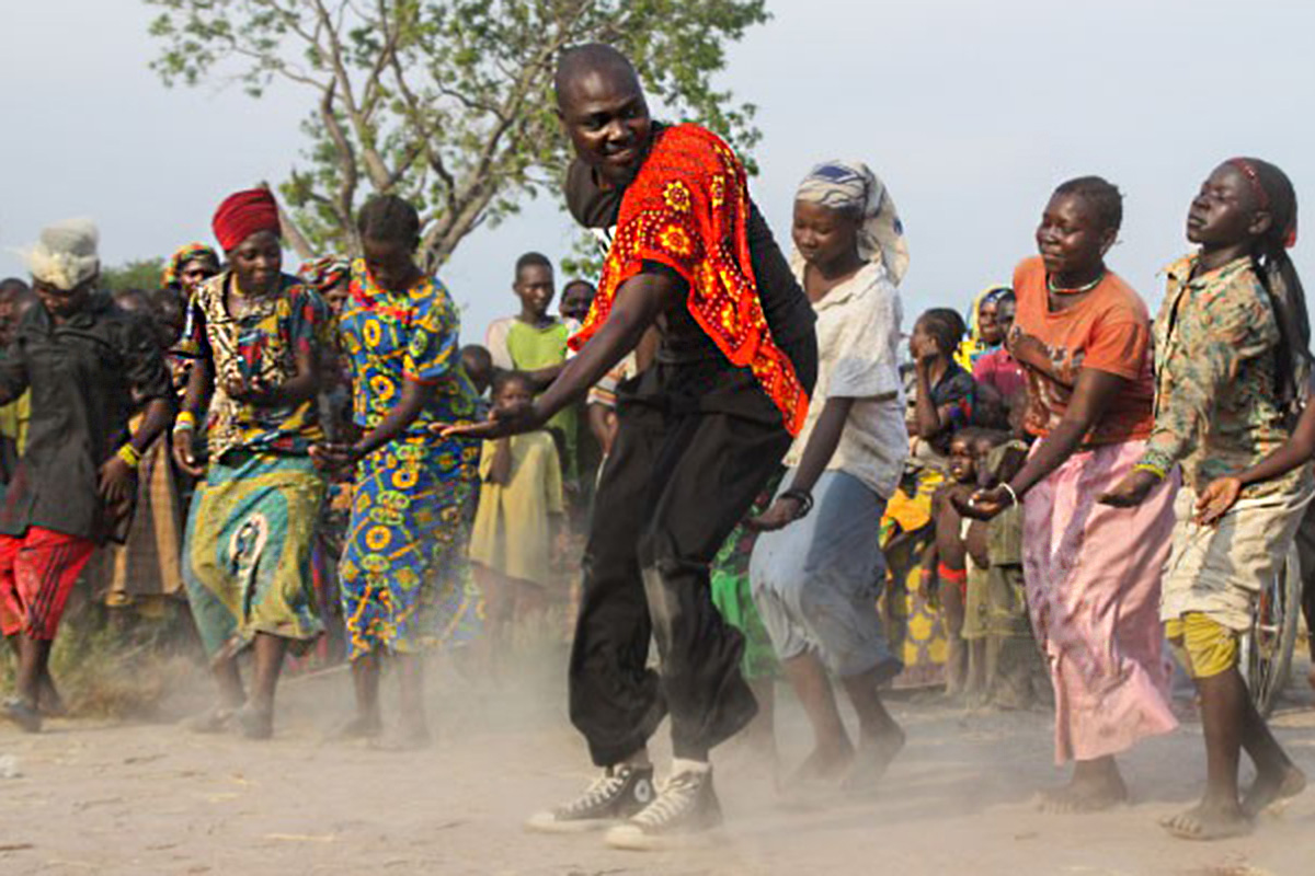 A man leads a group dancing