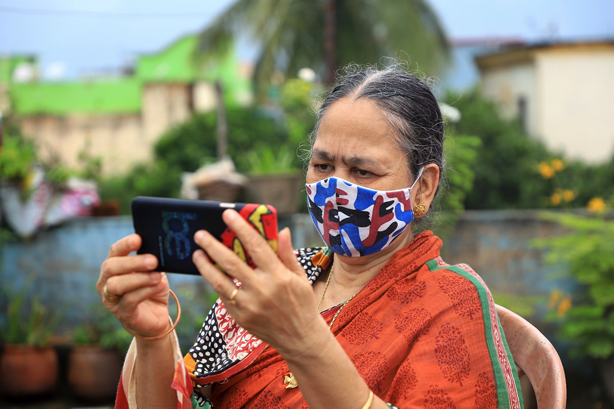 An older lady using a mobile phone
