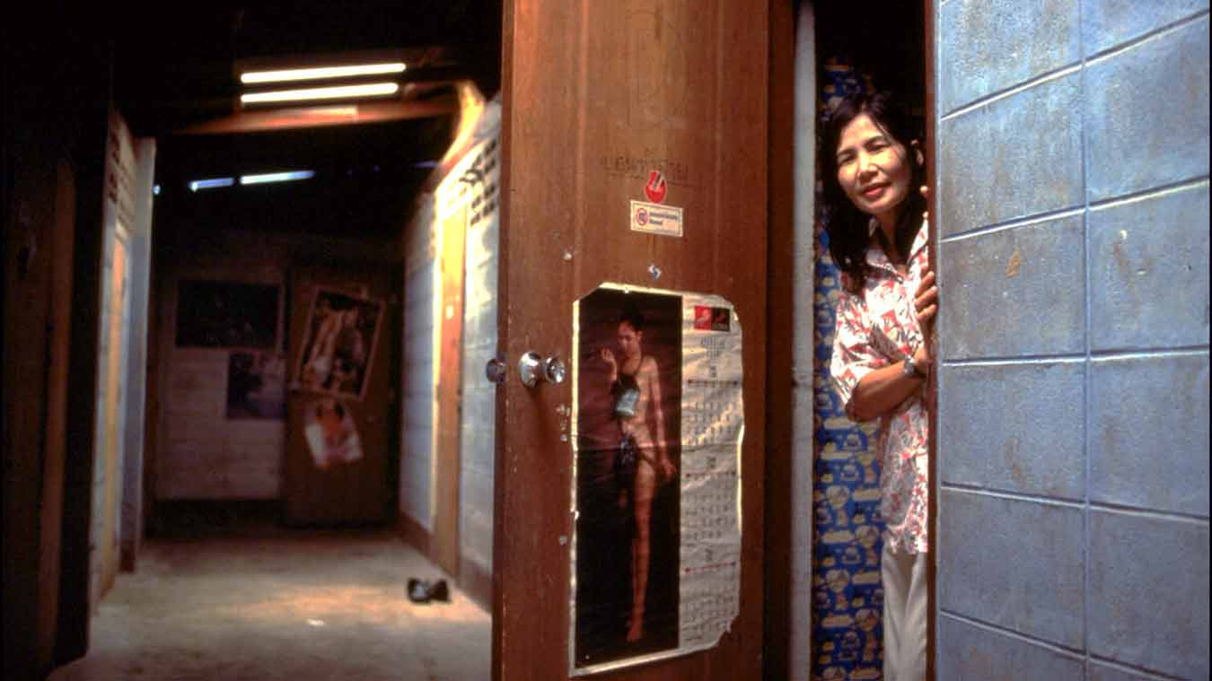 A sex worker stands in a doorway at Shipha House, a Brothel near the main bus terminal in the town of Phayao in northern Thailand.