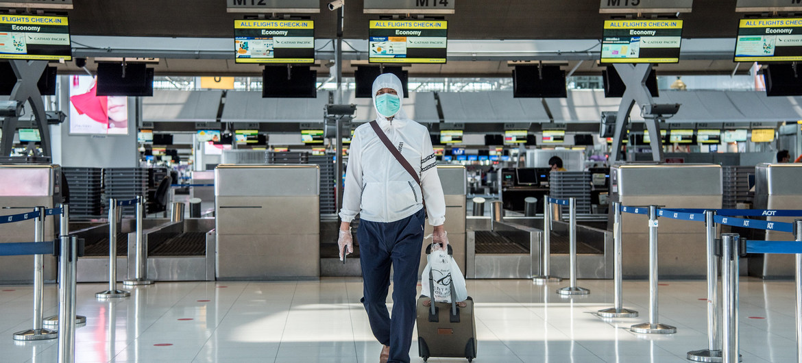 passenger with mask at airport