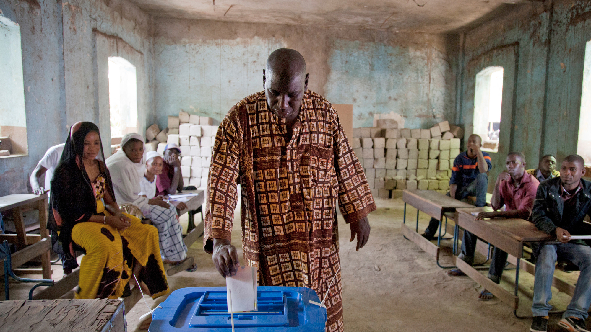 A man voting at a polling station in Mali in 2013.