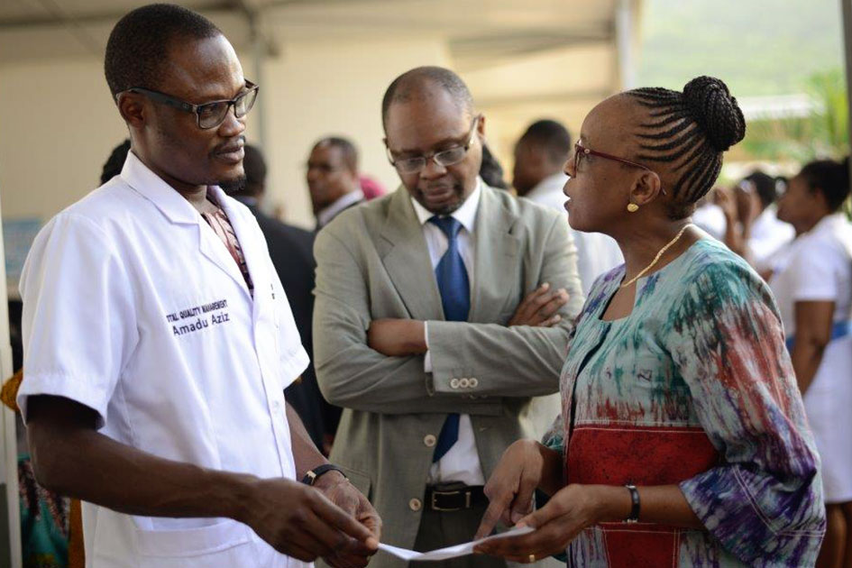 Dr. Moeti is on a field visit in a hospital and is seen in discussion with Mr. Aziz, QA officer.