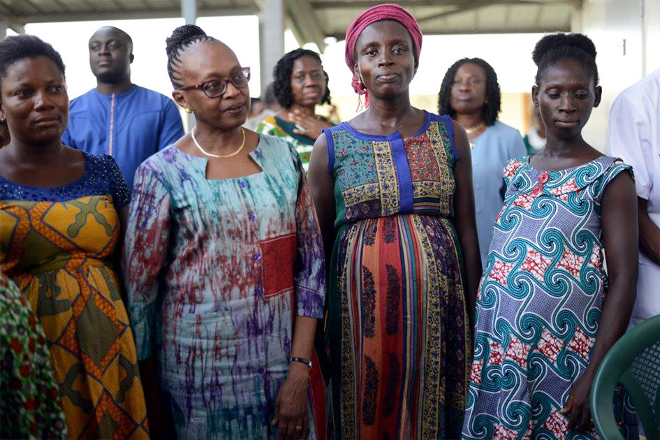Dr. Moeti stands next to pregnant women.