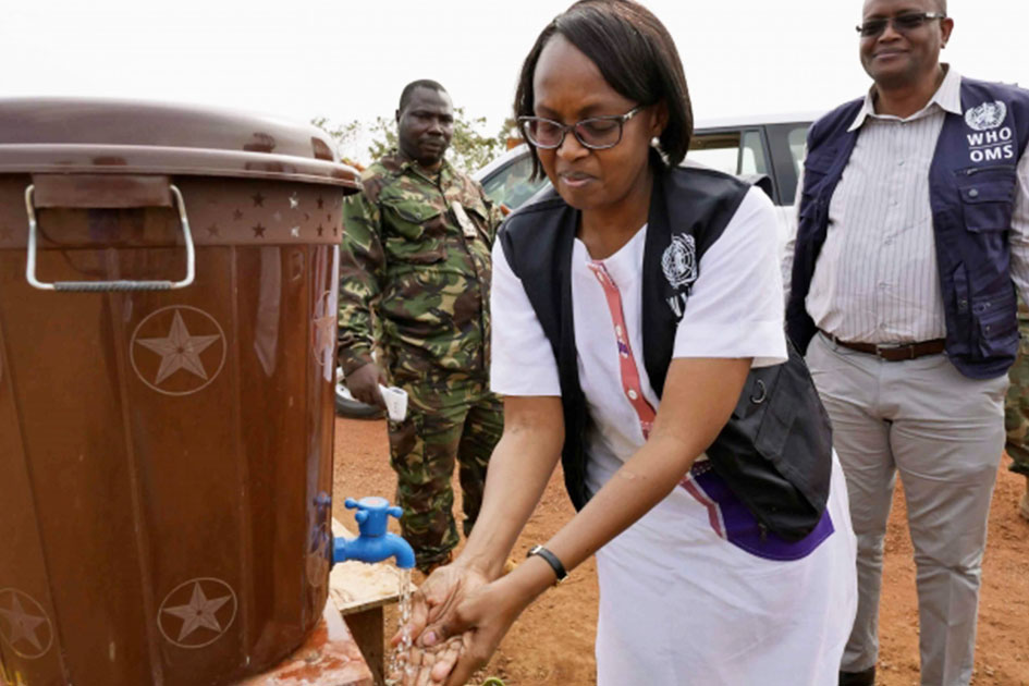 Dr.Moeti washes her hands at a portable wash station.