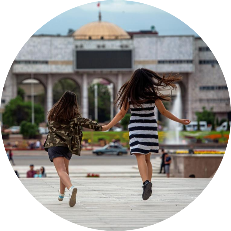Two Kyrgyzstani girls walk in the center of Bishkek.