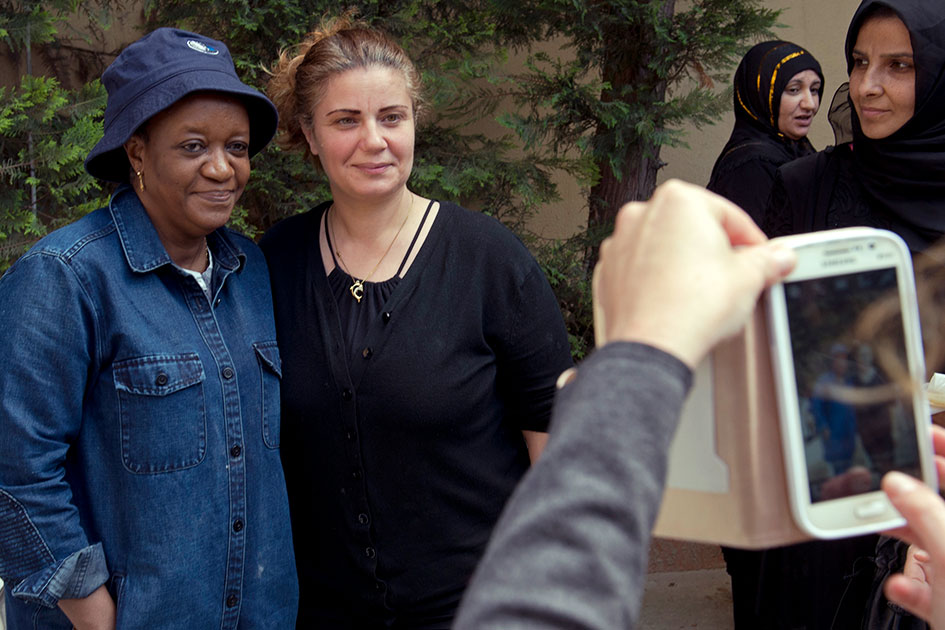 Zainab Bangura posing for a photo with a Syrian refugee woman.